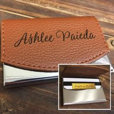 Personalized Laser engraved felt lined business card holder. The laser engraved a nice dark black crisp finish onto the Faux brown leather. Business card holder has a magnetic catch that holds it closed.  Size: 2 1/2 x 3 3/4 Inches  It makes a great personalized gift for any occasion. We can engrave it with a logo, Monogram, names, or anything else you can think of.  Please Include Font selection in the personalization box.