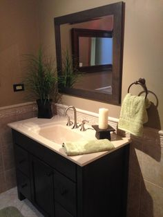 Great dark/light contrast in showroom bathroom remodel at the storefront!