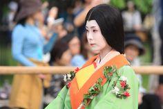 凛 A woman dressed in junihitoe