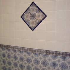 Hand painted Spanish bath tile create a striking accent for the shower wainscot. Spanish Bathroom, Spanish Tile, Master Bathroom, Coastal Powder Room, Bath Bomb Packaging, Traditional Tile, Natural Flooring, Colored Ceiling, Bath Tiles