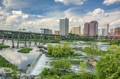 White water of the James River flowing by the City Skyline #woodnaaa #RVA #TheHurstTeam