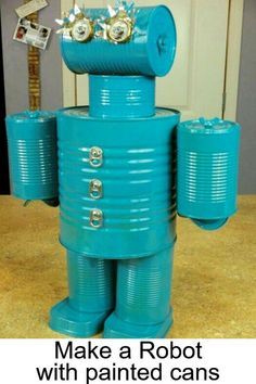 Crafts for Kids to Make for indoor or outdoor summertime fun. This easy DIY robot craft uses old cans and other household items - see more Summertime crafts and activities on this page Recycled Robot, Recycled Crafts, Recycled Clothing, Recycled Fashion, Summer Crafts For Kids, Crafts For Kids To Make, Summer Art, Kids Crafts, Tin Can Man