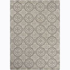 A thick, soft pile highlights this area rug. Hand-tufted in India using premium quality wool, this area rug features a beautiful floral design in shades of beige against taupe brown background.