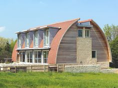 New curved roof house plan design in stylish and eco statement