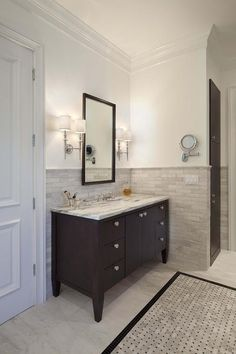 beach cottage bathroom features tongue and groove ceiling over grooved walls framing train rack over toilet beside white lacquer mirror over white vanity