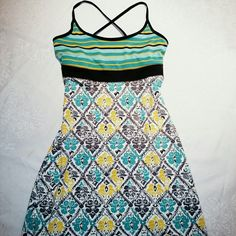 Sundress Cute little Lola dress in size small.  92% polyester and 8% spandex.  Machine wash cold water.  Only worn once so in great condition!  Built in shelf bra.  Non-smokers closet. lola Dresses