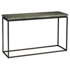 This console table boasts a warmly weathered planked top on a simple contemporary metal frame.         Product: Console table...