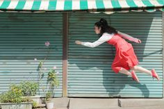 """Yowayowa Camera Woman Diary is a cool series by Japanese photographer Natsumi Hayashi featuring self-portraits where she seems to be levitating or simply floating in mid-air. """"Yowayowa Camera Woman looks as if she's doing a slow, lyrical dance through the air. The more complicated — in some cases, dangerous — the pose appears, the less inclined a viewer will be to anticipate a landing. Ms. Hayashi holds her head high, averting her eyes from her landing point. She releases he..."""