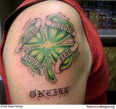 Irish clover tattoo on a man's upper arm