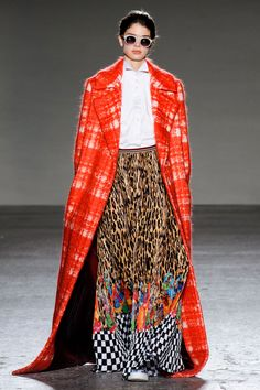 Fall2015- Stella Jean...In the end, the outerwear took center stage, with a plaid red dream that made even statement making coats feel staid. Worn with leopard-meets-Vans checks-meets-Indian-textile trousers and a very plain white cotton shirt, it's the perfect play of kitsch and classic.    - HarpersBAZAAR.com