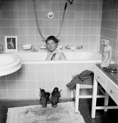 "American war correspondent Lee Miller  takes a bath in Hitler's Munich apartment on the day the owner committed suicide. Miller was a correspondent for ""Vogue» and worked with photographer David Sherman, who took this picture, April 30, 1945. Lee and Sherman went to Munich together with the 45th Division. They found an abandoned building at the undamaged Prinzenregentplatz, 27, went in, and they realized that it was Hitler's personal quarters. They stayed there for three days."