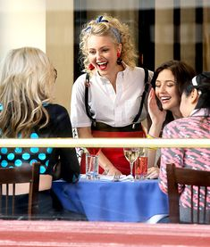 AnnaSophia Robb shares a laugh with her costars while filming her CW show, The Carrie Diaries, in New York City.