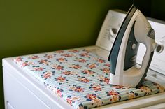We really do not use an iron very much at all. I would like the nix the fold down ironing board idea. I think that I could create a pad like this. I'm pinning it so I remember the concept ...