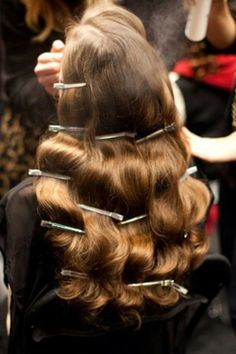 For 40s inspired curls, set each wave with a crocodile clip to cool