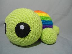 A rainbow striped amigurumi turtle which is the rainbow tiny-er turtles' (http://www.ravelry.com/patterns/library/rainbow-tiny-er-t...) big mama.