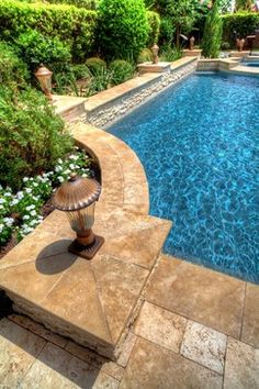 I like the travertine, coping, and wall with raised tiling for waterfall area / Grecian / Roman Style Pool 1