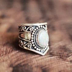 This intricate white opal ring.   25 Gemstone Rings That Prove Diamonds Aren't A Girl's Best Friend