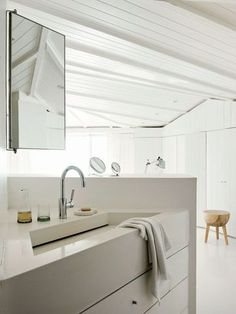 White bathroom with stone washbasin