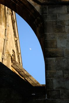 Flying buttresses on Winchester cathedral, with moon.