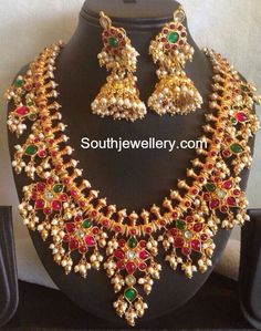 22 carat gold guttapusalu haram and matching jhumkas set adorned with kundans, polkis and pearls. Related PostsGuttapusalu HaramGuttapusalu HaramRani Mukherjee in Gutta Pusalu HaramGoddess Lakshmi Guttapusalu HaramKundan Guttapusalu HaramAntique Gold Necklace and Guttapusalu Haram