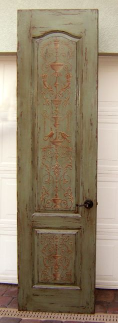 a great look on an old vintage door is to paint or stencil a design on it like this door.... Painted door by Jeff Huckaby