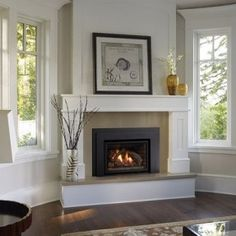 Contemporary Gas Fireplace Inserts With White Fireplace Mante Contemporary Gas Fireplace Inserts With White Fireplace Mante Molly Kamine Contemporary Gas Fireplace Inserts With White Fireplace Mantel Surround nbsp hellip Corner Fireplace Mantels, Corner Electric Fireplace, Fireplace Mantel Surrounds, Fireplace Tile Surround, Bedroom Fireplace, Fireplace Hearth, Fireplace Remodel, Fireplace Design, Fireplace Ideas