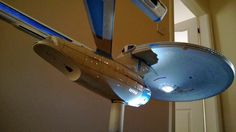 USS Enterprise model, which is residing above the wardrobe in the kids' room.  The model was constructed over a course of a few months, which involved internal lighting, using eBay sourced LEDs, as well as making sure there was no light leakage. The power source was purchased locally and all the lights still seem to be working.  This was constructed in the mid 2000s.