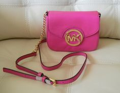 """This sleek leather crossbody by Michael Kors is perfect for afternoons around town or a night out with your crew. Anchored with the iconic MK monogram, the hands-free design is ideal on the go. Awesome Gift Choice! Retails at $148.00. Item Details:  Leather;Adjustable crossbody strap with 25"""" dro..."""