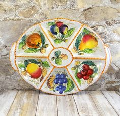Beautiful Italian Majolica serving tray by E & R Circa 1970s. Measures 15 1/2 inches by 11 3/4 inches by 3/4 inches high. Beautifully colored with red, blue, green, yellow, orange and brown, this serving tray could be used for various cheeses, olives, meats, crackers, dipping oils, etc. Some minor manufacturing blemishes to the glaze, please view all photos.
