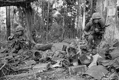 Battle of Dak To, 1967 / A member of the 173rd Airborne Brigade crouches beside the body of a dead comrade and equipment left by wounded at the height of the battle on Hill 875. U.S. Army paratroopers of the 173rd Airborne Brigade began a final assault up the bloody slopes of Hill 875. ~ Vietnam War