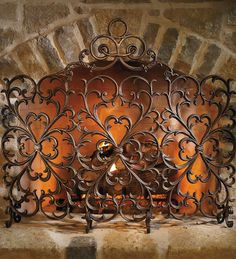 The symmetrically proportioned Cast-iron Scrollwork Fireplace Screen brings the infinite beauty of cast iron to your hearth.