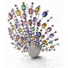 White and black gold Peacock brooch with diamonds, and precious stones (sapphire, rodolite, topaz, citrine, amethyst and iolite) by Roberto Coin