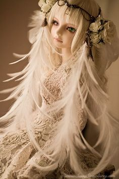 white feathers...Asian-style ball jointed doll