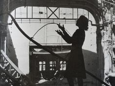 Diva, Irmgard Seefried singing Madame Butterfly's aria in a bombed out Vienna Opera House,1945 by Lee Miller