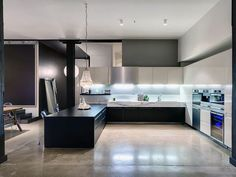 concrete kitchens | Black kitchen countertop with polished concrete floors. Wool store ...