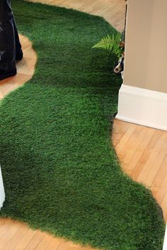 use a grass mat for the boys room when making a jungle themed room for a fun addition