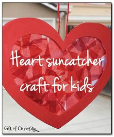 Heart suncatcher craft for kids. Perfect for Valentine's Day or just for showing some love. || Gift of Curiosity
