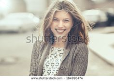 Beautiful young woman smiling - stock photo