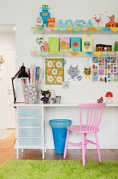 Pretty pink chair with desk for little girl's room.