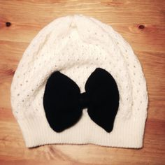 Cute F21 Bow Beanie Adorable knit beanie from Forever 21. Off-white yarn with black bow. Very stretchy. Great used condition, worn but no visible wear. Let me know if you have any questions! I offer the highest bundle discounts!:) Forever 21 Accessories Hats