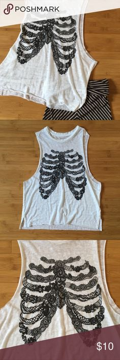 """Express Lace Ribcage Muscle Tank White burnout muscle tank. Black lace printed ribcage on front. Large open armholes. Sheer. Worn once and in excellent condition. Approximately 23"""" across the bust when laid flat and 17"""" from shoulder to hem. 50% polyester, 38% cotton, 12% rayon Express Tops Muscle Tees"""