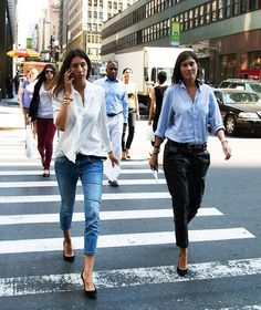 Geraldine Saglio in a white button-up + skinny jeans + black heels and Emmanuelle Alt in a blue button-up + black leather trousers + black heels