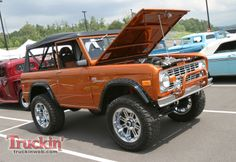 classic orange Ford Bronco hood open
