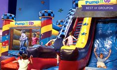 Kids unleash excess energy on an indoor playground of inflatable attractions