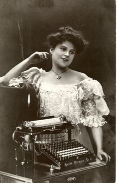 Not quite a book, but still the happiest woman with a typewriter I've ever seen.