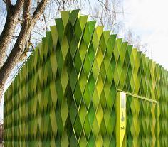 Public prefab restroom in Uster (CH), architects Gramazio & Kohler slapped 295 bright green, laser-cut, folded aluminum strips.