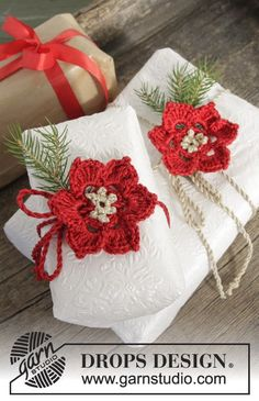"DROPS Christmas: 'It's a Wrap' - Crochet DROPS flower in ""Cotton Viscose"" and ""Glitter"" ~ DROPS Design Free Pattern."