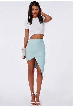 Simple yet effective, this pwder blue asymmetric midi skirt will make any outfit. It'll be all eyes on you when you go out in this crepe stretch bodycon number. Simply team with a crop top, strappy heels and envelope clutch.  Approx lengt...