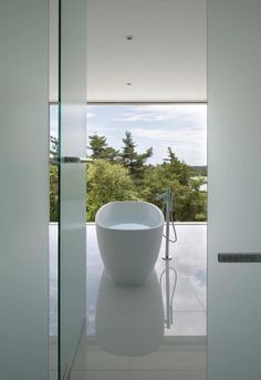 The perfect view for a long soak! Image via Designed for Life.