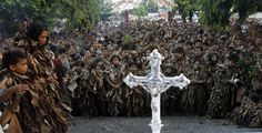 Devotees covered with mud and dried banana leaves pray in front of a cross during a religious ceremony that celebrates the feast day of their patron Saint John the Baptist, in the village of Bibiclat, Nueva Ecija, north of Manila, Philippines. Religious Ceremony, Banana Leaves, Mary Magdalene, Manila Philippines, Saint John, John The Baptist, Holy Family, Patron Saints, Human Nature
